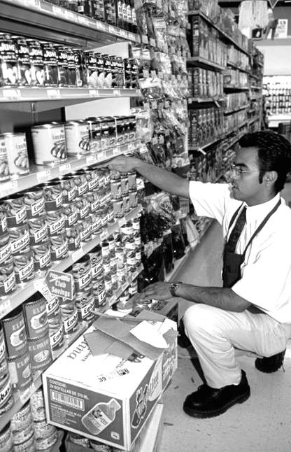 stocking_the_shelves_in_a_supermarket_BC4363.jpg